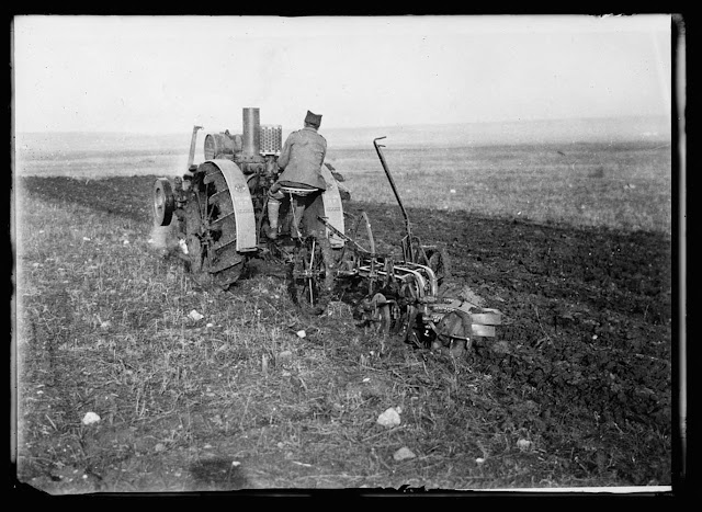 American tractors in Serbia. The American Red Cross has thirty farm tractors tilling the soil in southern Serbia. These modern machines are proving a great boon to the Serbian Farmers who have been wothout agricultural implements for four years and whose land has been idle for want of the plough all during the war
