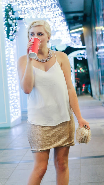 Fashion and Travel Blogger GlobalFashionGal (Brianna Degaston) wearing a rose gold sequined skirt during the Christmas time at Orchard Road in Singapore.