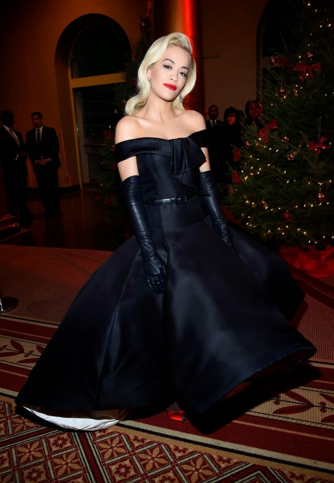 Rita Ora in an off-shoulder black gown at the 2014 TNT Christmas event in Washington