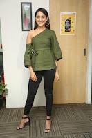 Pragya Jaiswal in a single Sleeves Off Shoulder Green Top Black Leggings promoting JJN Movie at Radio City 10.08.2017 080.JPG