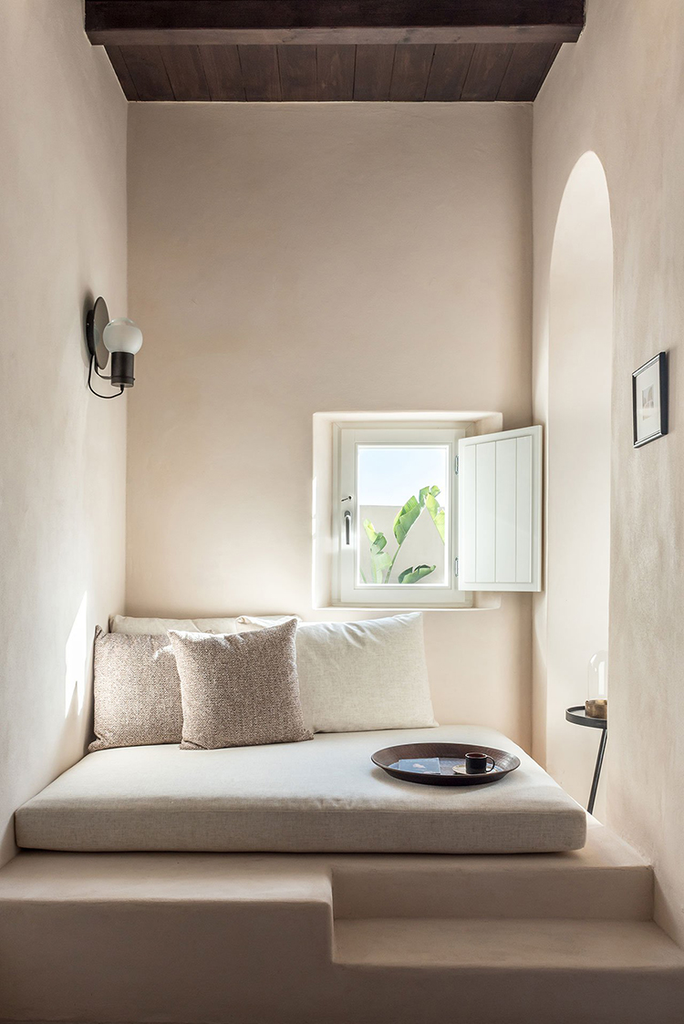 ISTORIA Boutique Hotel designed by Interior Design Laboratorium. Photo by Giorgos Sfakianakis. Built-in daybed, contemporary minimalistic interior, modern rustic bedroom, boutique hotel in Santorini, designer hotel in Santorini