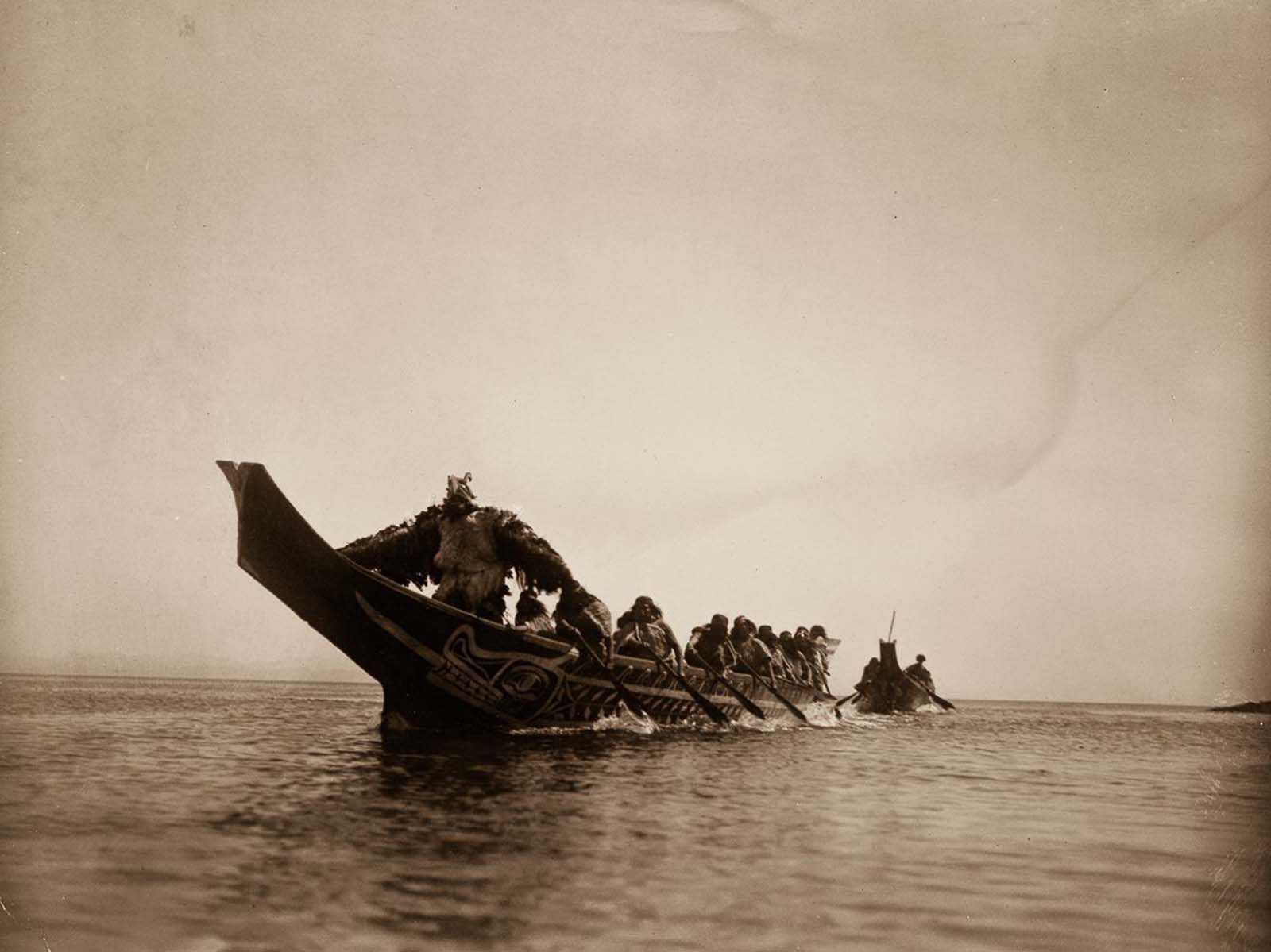 Kwakiutl people in canoes in British Columbia. 1914.