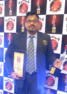 Mr. Ravi Nair, Country Head - HR, Topsgrup receiving award 1