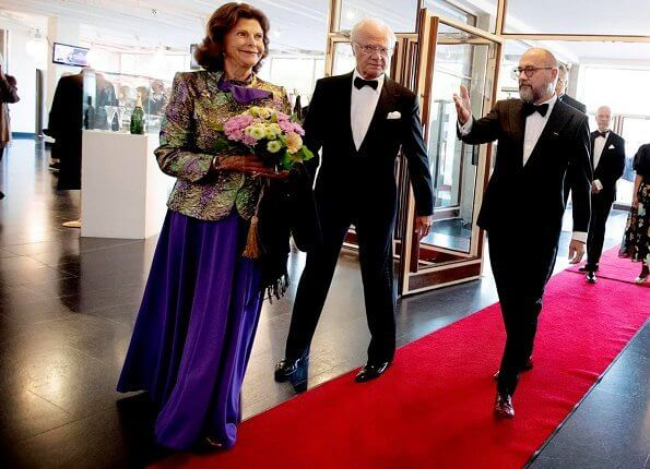 Queen Silvia is wearing sequin blazer and pleated maxi skirt