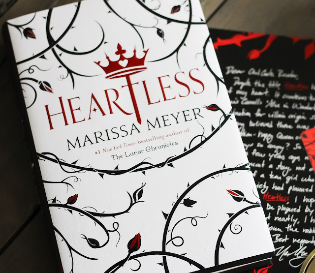 Heartless by Marissa Meyer a fractured fairytale fantasy about how the Queen of Hearts in Wonderland became the Queen.  Really great idea for a story, but with such an idea I feel it should've been more character driven rather than plot driven.  More of a love story.  YA lit, young adult literature, teen reads, Lewis Carrol, Alice in Wonderland, kind of like Wicked of Alice in Wonderland. Alohamora Open a Book http://alohamoraopenabook.blogspot.com/