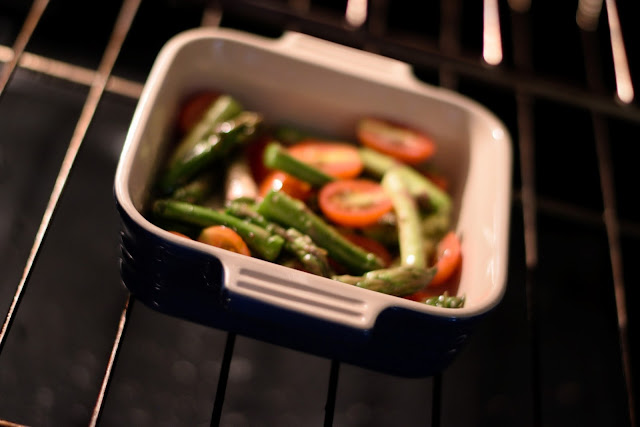 The asparagus and tomatoes baking in the oven.