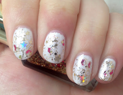 Essence The Little X-Mas Factory in Let's Take an Elfie with Barry M Jingle Bells glitter topper nail polish
