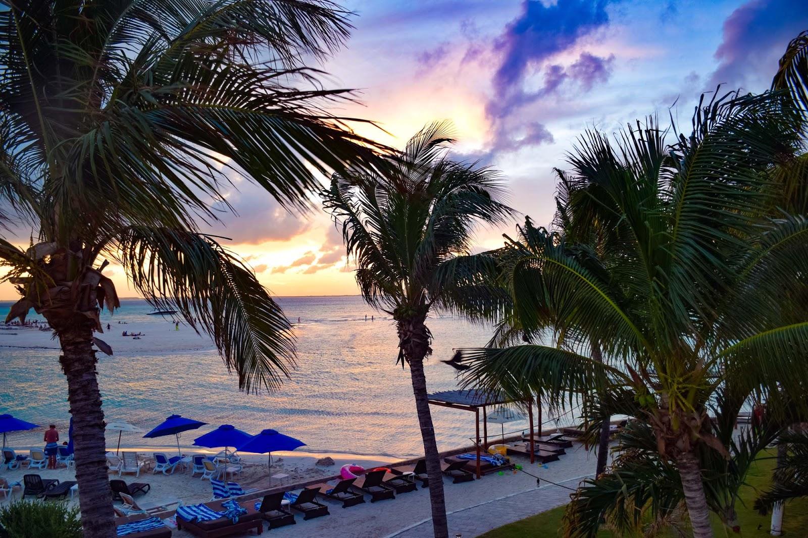 sunset island mujeres