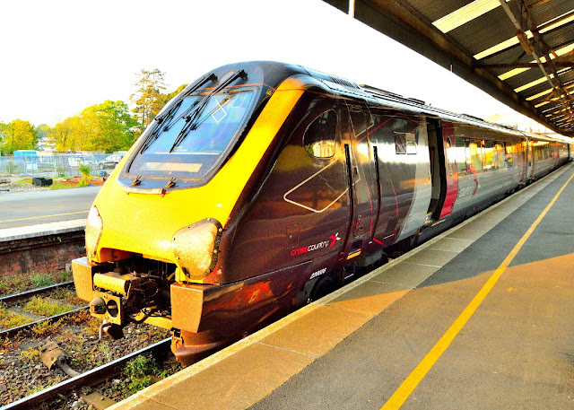 'Cross Country Trains' Class 220 006 stands in Truro railway station, Cornwall, in the dying rays of the sun.