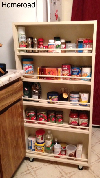 Slide out pantry filled with dry goods
