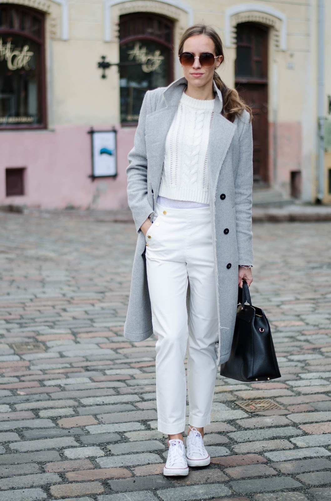 kristjaana mere minimalist casual winter white outfit wool coat white pants sweater sneakers