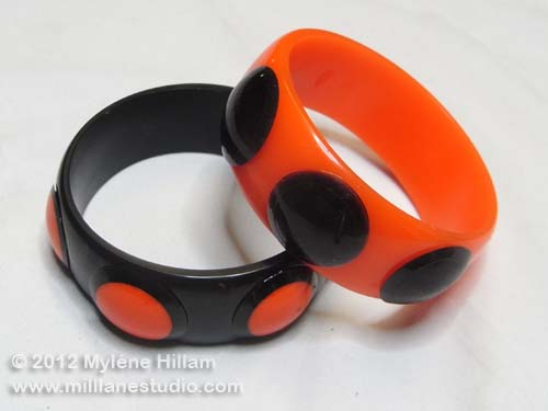 Orange and black spotted resin bangles.
