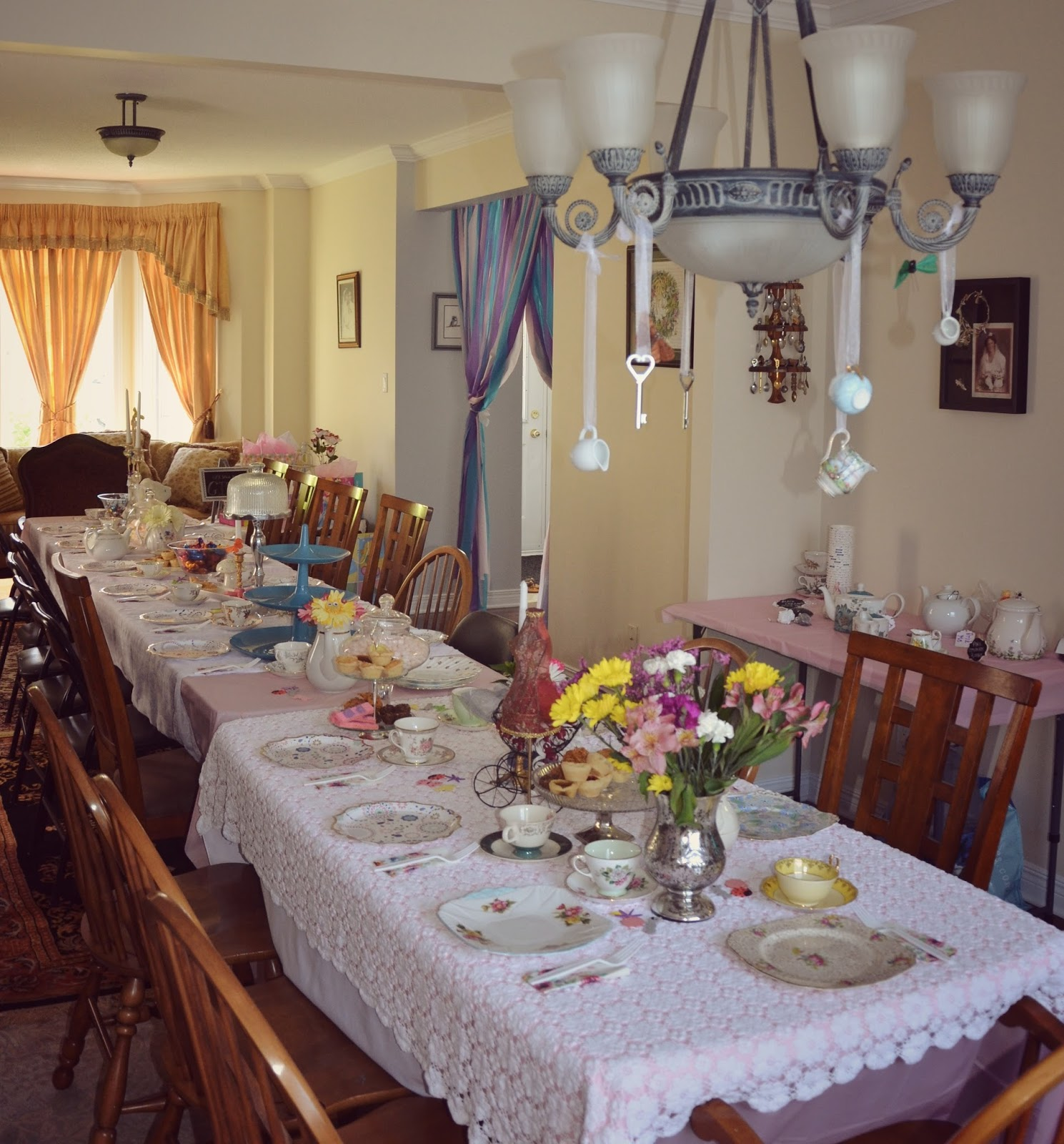 Suburban wallflower alice in wonderland tea party baby shower to the alice in wonderland franchise some of my favourite details include the tea cups hanging from the chandelier and googly eyes on the flowers arubaitofo Choice Image