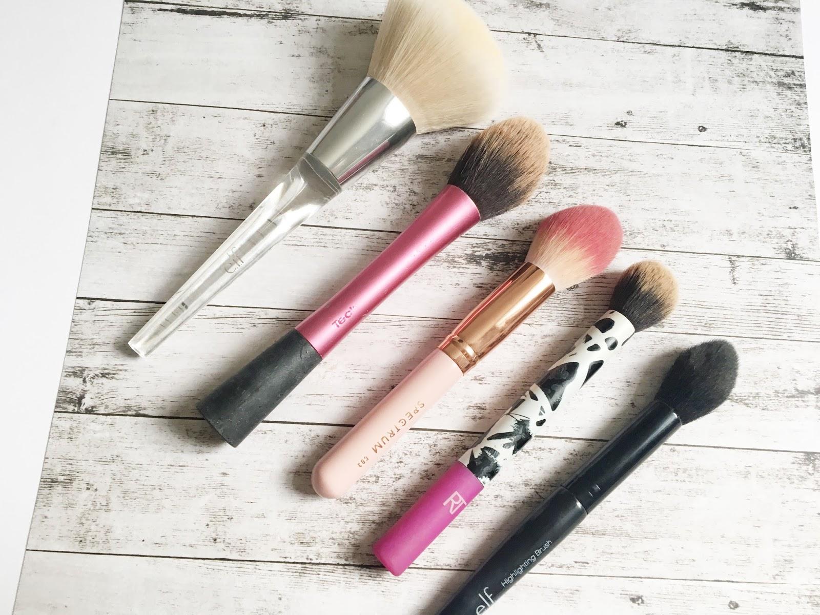 spectrum bombshell brushes. l to r \u2013 elf powder brush. spectrum c03, rt contour brush, highlighting brush bombshell brushes