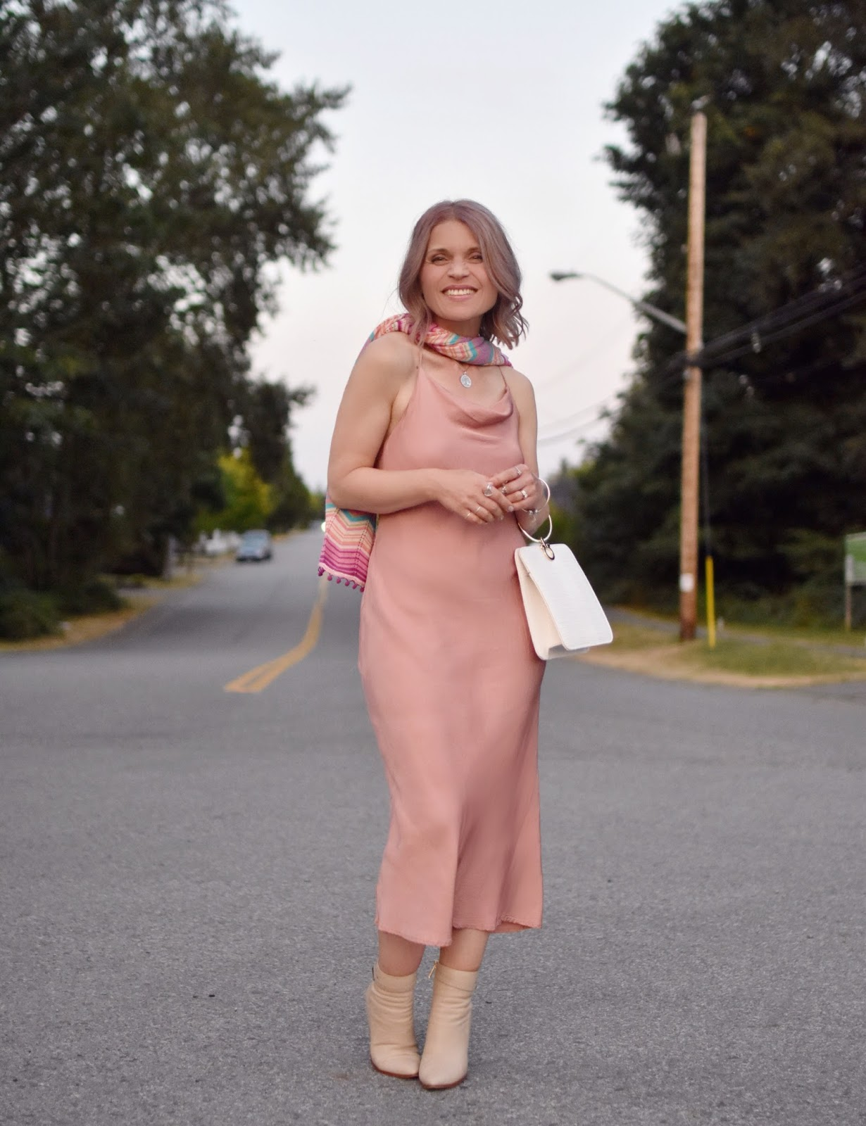 Monika Faulkner personal style inspiration - pink midi-length slip dress, Missoni-inspired knit scarf, ivory booties, and ring-handle bag