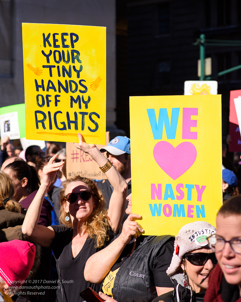 a photo of protesters with nasty women signs
