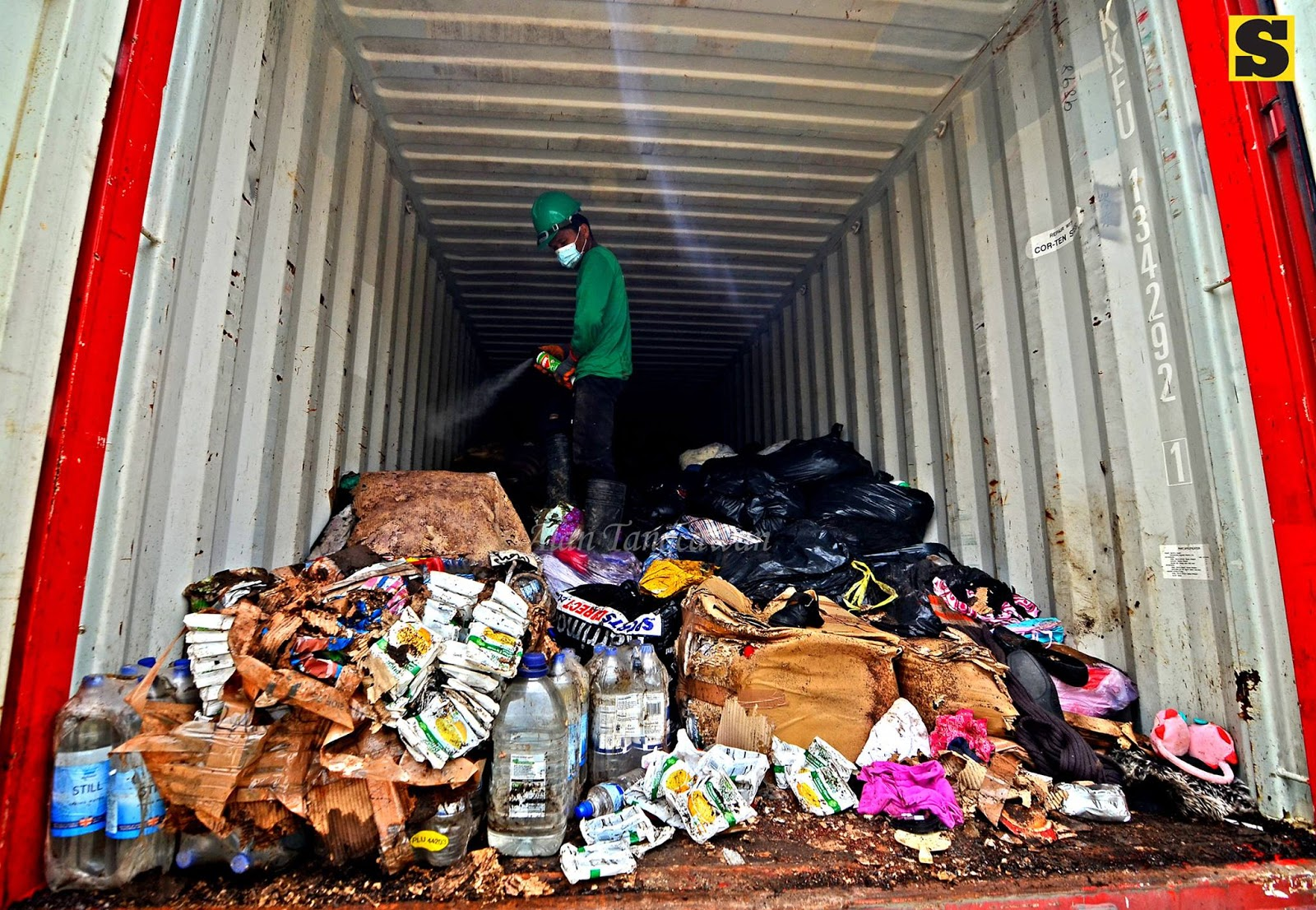 BOC destroys 4 container vans of expired 'Yolanda' donations