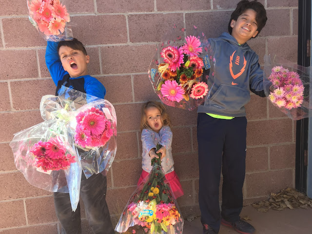 Kids giving a away flowers in downtown Santa Fe, NM