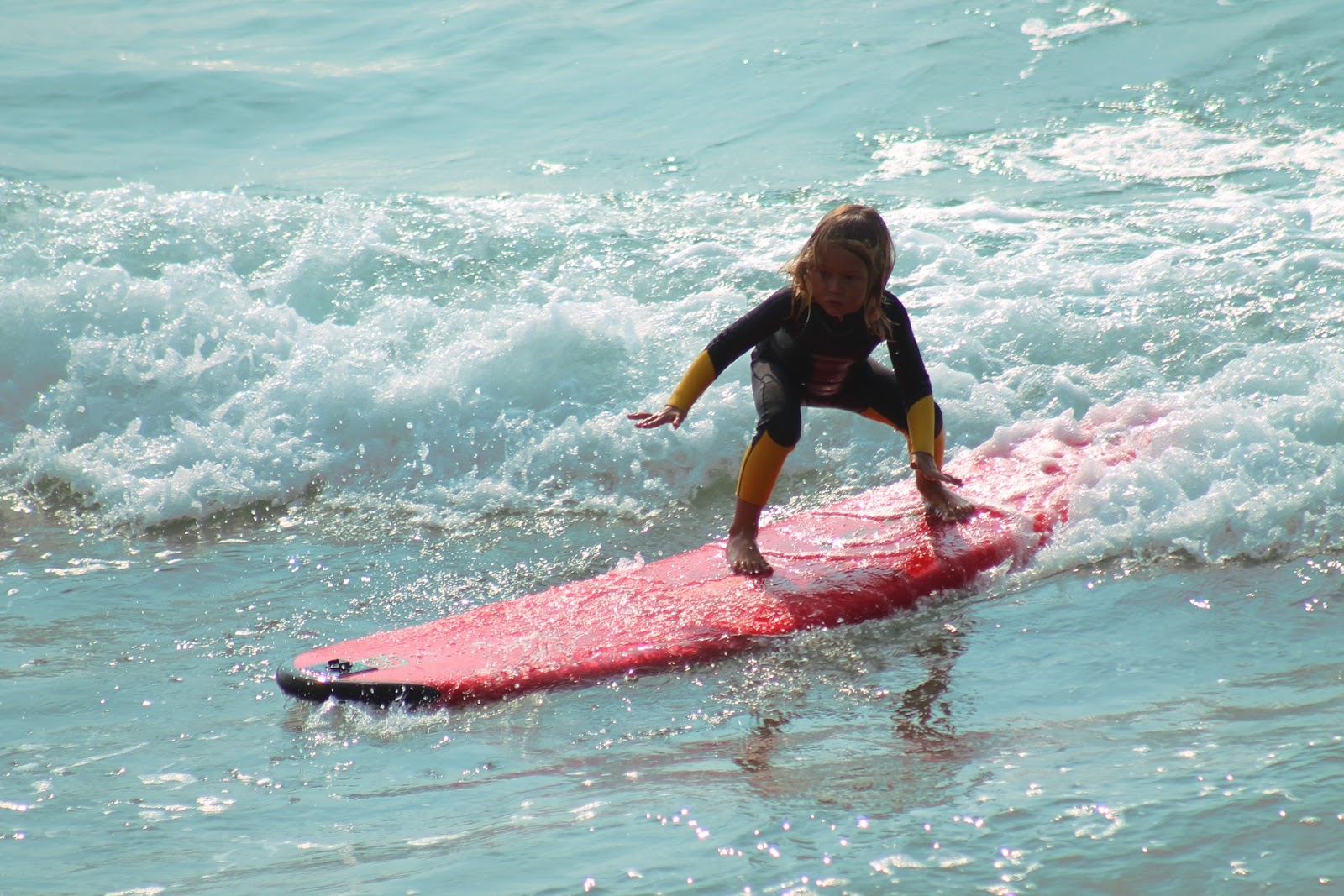Top Outdoor Adventures in Europe for Thrill Seeking Families - surfing in Santander