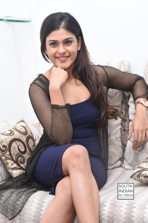 Naira Shah smiling Beauty in net top and short blue dress at E Ee movie