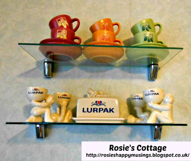 Cappuccino Cups & Ceramic Lurpak Collectables Sit On Glass Shelves To Make Us Smile.