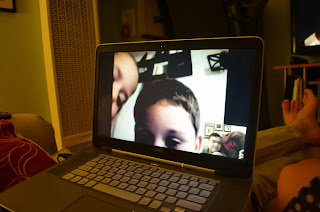 skyping with kids on a laptop
