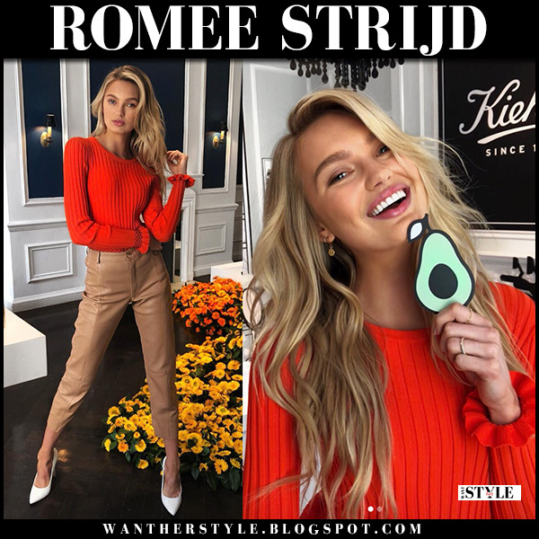 Romee Strijd in red knit sweater altuzarra malou and beige leather pants with white pumps model style april 26