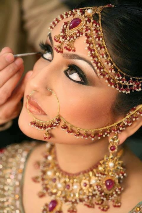 Kohl (Anjana or Kajal) application in bride's eyes