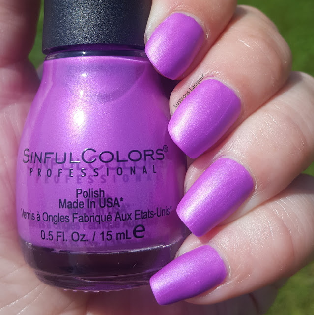 Byzantine purple neon nail polish with magenta shimmer