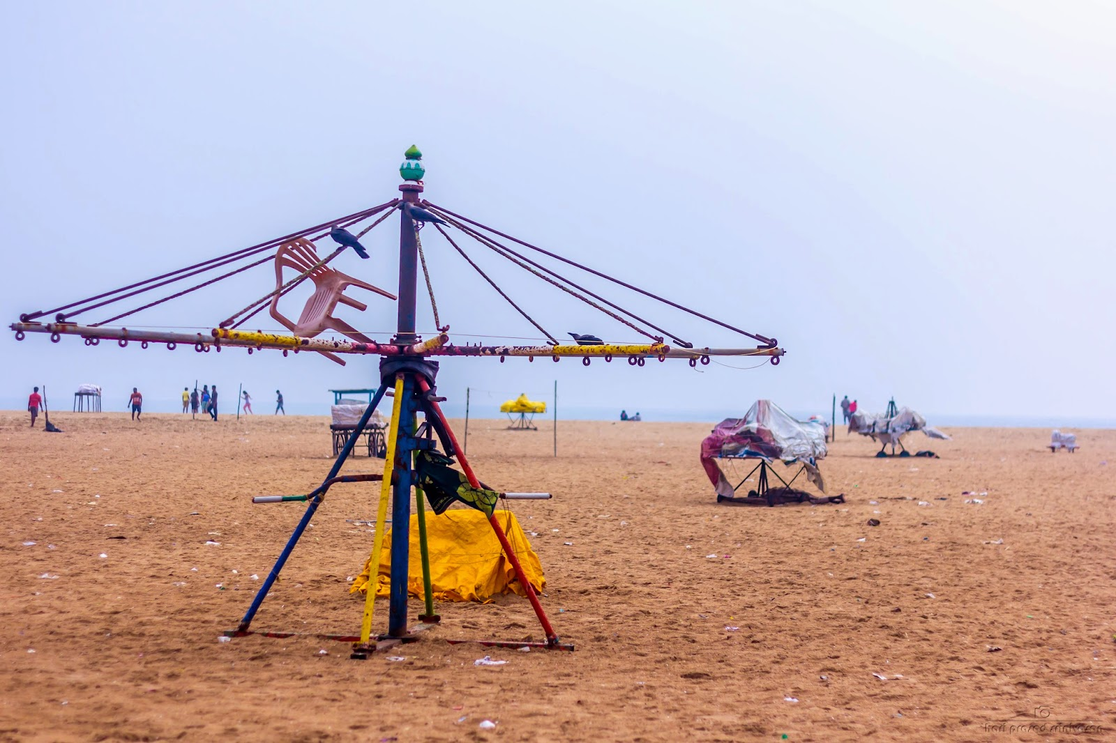This is the larger version of the merry go round in Chennai beach on which Adults can use. Photo taken on a cloudy day.