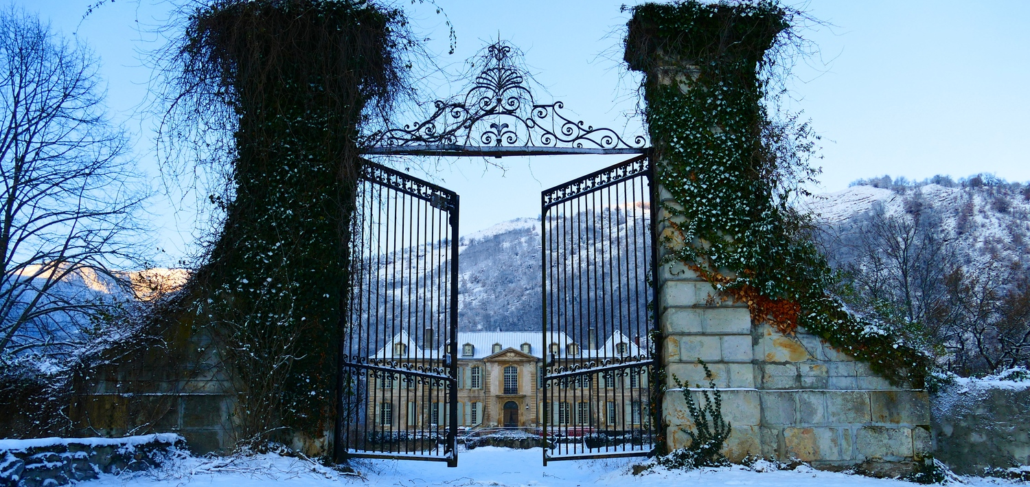 Picturesque gate to Chateau de Gudanes in mountains of Verdun