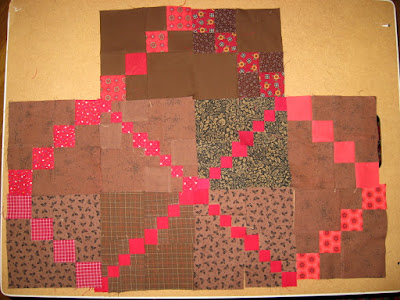 red and brown double four-patch quilt blocks with triple four-patch layout
