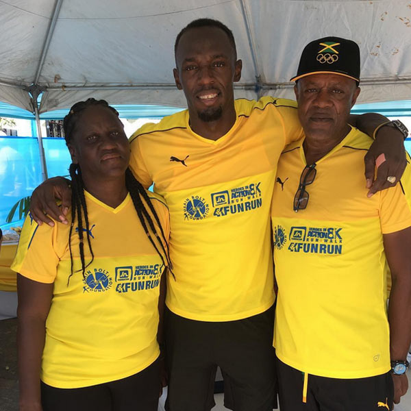 Usain Bolt shows off his parents