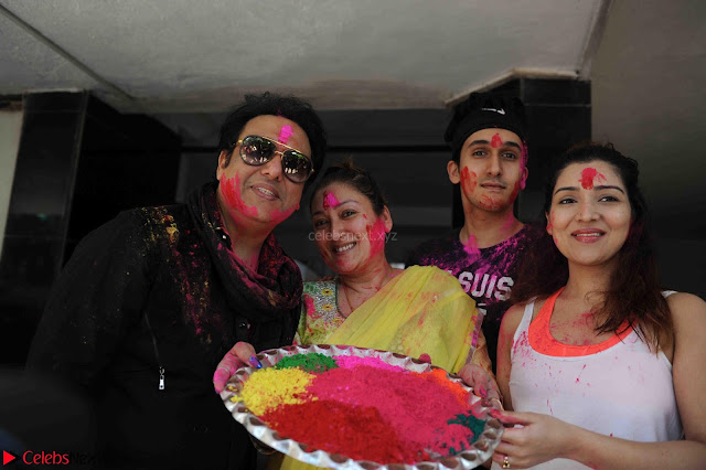 Govinda celeting Holi with His family wife daughter 004.JPG