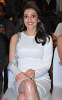 Beautiful Smiling Kajal Aggarwal in Creamy White Gown at MLA Telugu Movie Success Meet ~ .com Exclusive Pics 010.jpg