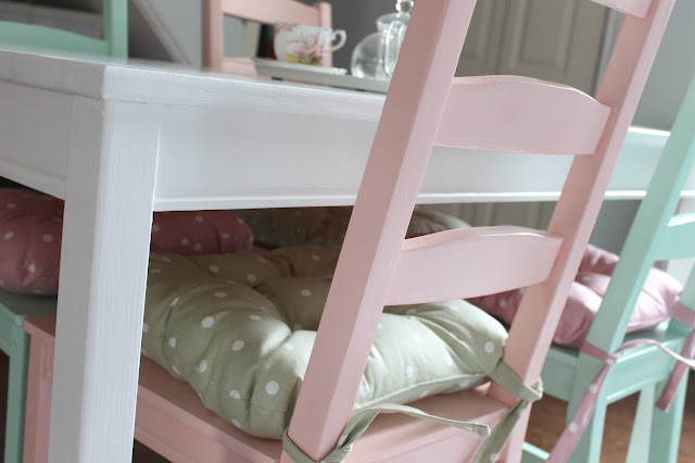 close up of pink chair with green polka dot cushion and green chair with pink polka dot cushion