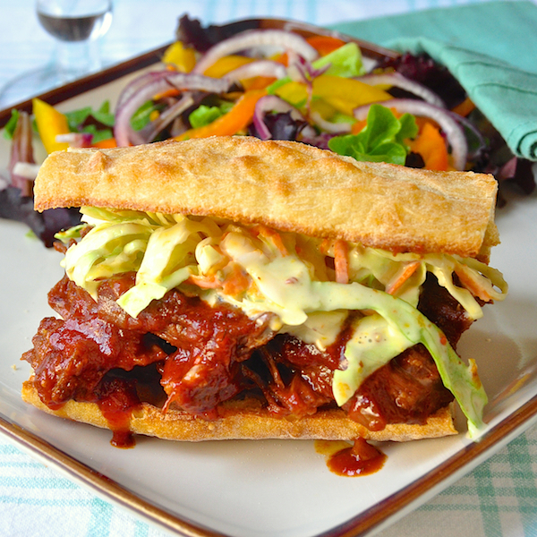 Honey Barbecue Pulled Beef Sandwiches with Creamy Dijon Coleslaw - tender beef, slow braised in an easy, smoky homemade barbecue sauce then served on toasted buns or crusty bread with delicious Creamy Dijon Coleslaw. The perfect way to feed a crowd on game day and a real pot luck favorite too.