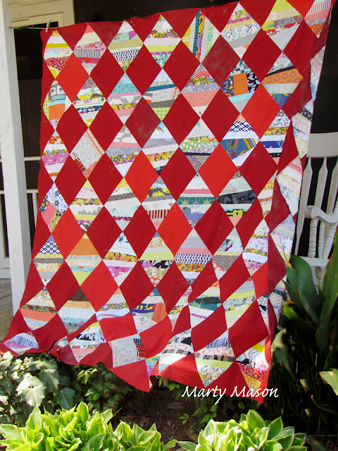 String quilt with shades of red - patchwork by Marty