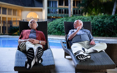 Hart and Green, relaxing by the pool - photo from parade.com