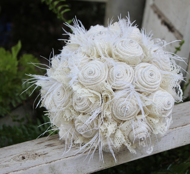 Rustic burlap and lace bride's bouquet with feathers