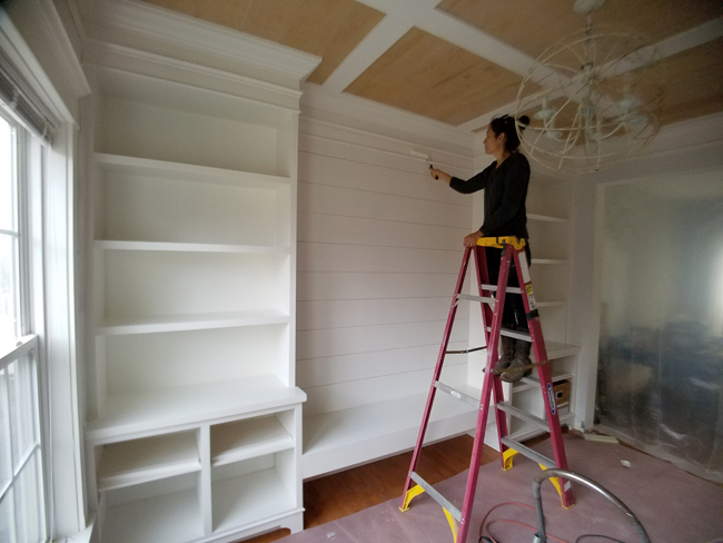 Cristina Garay On Ladder Painting The Planked Wall