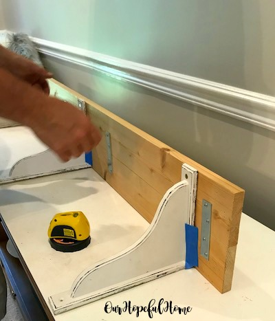 distressed corbel DIY shelf mending plate laser level painters tape