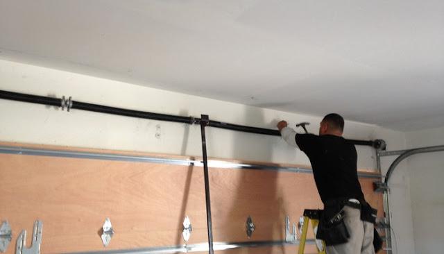 how to repair garage door bottom seal