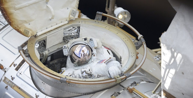 NASA astronaut Ricky Arnold exits the Quest airlock at the start of U.S. EVA-51. Photo Credit: Oleg Artemyev / Roscosmos