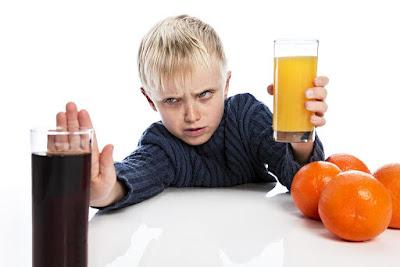 A boy refuse cola
