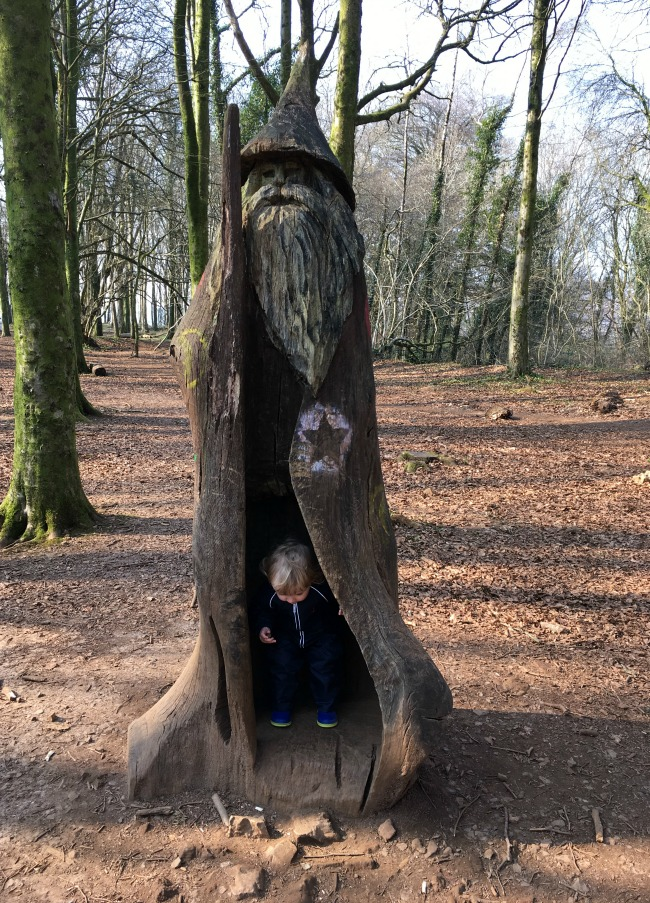 #MySundayPhoto Number 12 toddler inside a wizard carved from a tree trunk