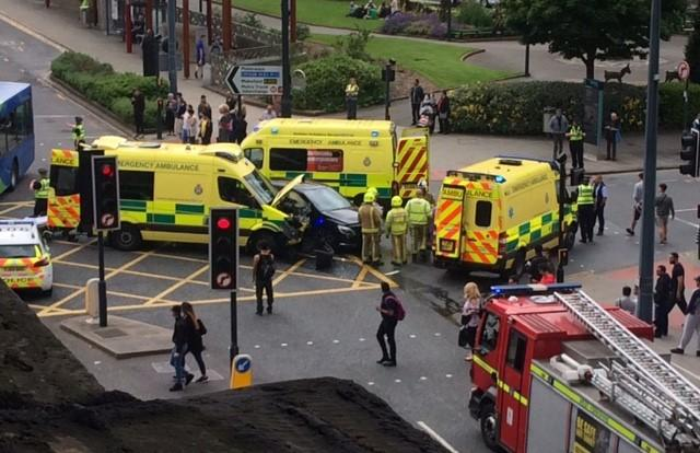 Ambulance involved in collision with car at junction in Bradford city centre