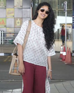 Keerthy Suresh in White and Maroon Dress with Cute Smile Captured at Hyderabad Airport 2