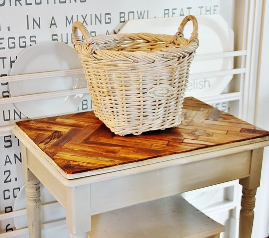 The counter top of this kitchen table made from stained wood sticks is unexpected and rustic.