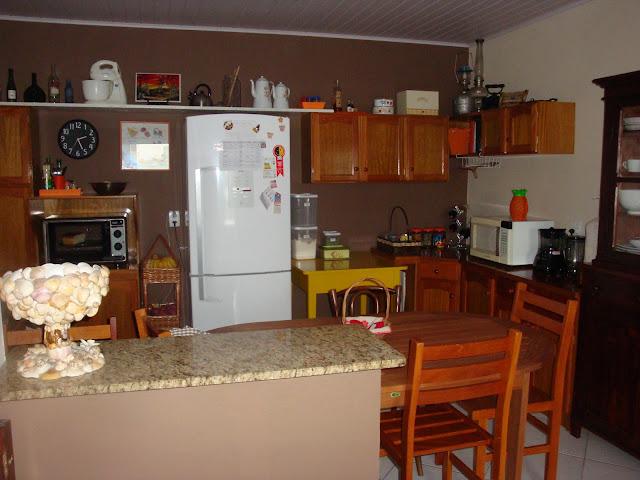 Cozinha e sala de jantar em mini apê